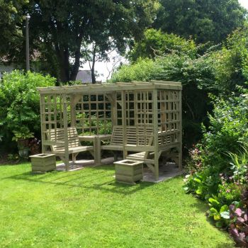 The Riviera Seated Pergola, wooden garden corner arbour seat with table and trellis – Assembly included